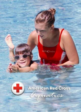 swim lesson instructor in the pool with child